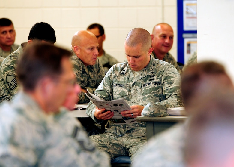 U.S. Air Force 1st Lt. Adam Cassidy, 145th Logistics Readiness Squadron, Installation Deployment Officer, looks through a list of charities during a meeting kicking off the 2014 Combined Federal Campaign (CFC) fundraiser at the North Carolina Air National Guard base, Charlotte Douglas Intl. Airport, Oct 10, 2014. CFC is the world's largest and most successful annual workplace charity campaign.  Pledges made and donated by Federal employees and military members provide health and human service benefits throughout our neighborhoods, cities, country and world. (U.S. Air National Guard photo by Master Sgt. Patricia F. Moran, 145th Public Affairs/Released)