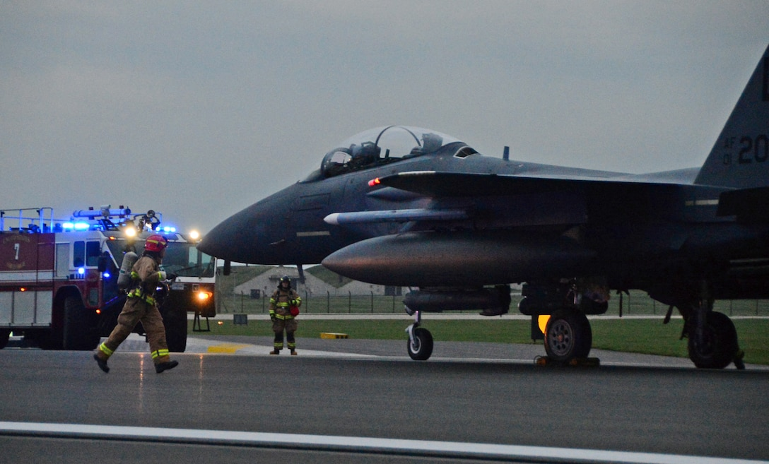 An F-15E Strike Eagle assigned to the 494th Fighter Squadron catches a cable during the certification process of new aircraft arrest barrier engagement systems on the runway at Royal Air Force Lakenheath, England, Oct. 15, 2014. The replacement system was installed on the flightline and is undergoing a certification process, saving the Air Force money and ensuring optimum safety of 48th Fighter wing assets. (U.S. Air Force photo by Airman 1st Class Erin O'Shea/Released)