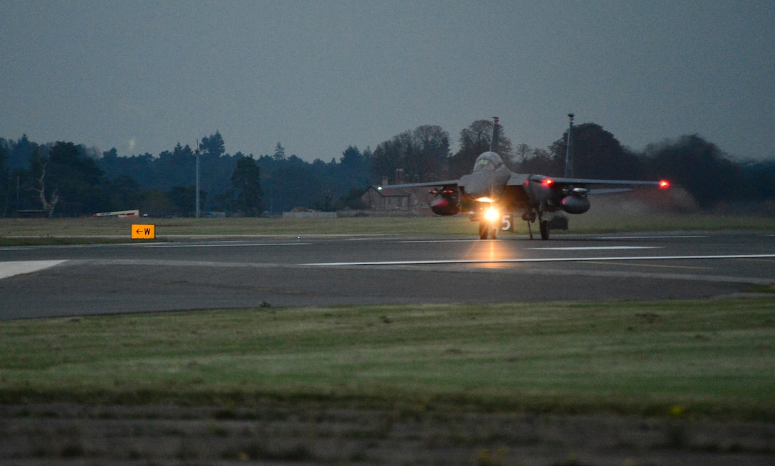 An F-15E Strike Eagle assigned to the 494th Fighter Squadron catches a cable during the certification process of a new aircraft arrest barrier engagement system on the runway at Royal Air Force Lakenheath, England, Oct. 15, 2014. The cables are strategically placed along the runway to stop aircraft if hydraulic systems or brakes fail. (U.S. Air Force photo by Airman 1st Class Erin O'Shea/Released)