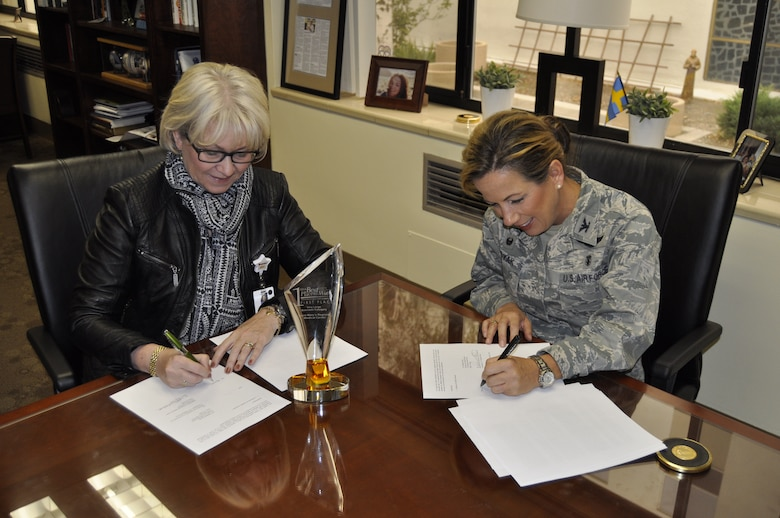 Helen Lidholm (left), CEO of St. Mary's Regional Medical Center here in Reno, and Col. Shanna Woyak, 152nd Medical Group Commander, sign a Training Affiliation Agreement (TAA) between the 152nd Medical Group and St. Mary's.  The TAA will allow medical technicians from the 152nd Med Group to perform hands-on medical training, under staff supervision, at St. Mary's.  U.S. Air Force photo by Capt. Jason Yuhasz. (RELEASED)