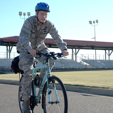 Maj. David Dawson, Air Force Officer Training School director of staff, rides his bicycle after work Oct. 17, 2014. For more than two decades Dawson has made the personal choice to ride his bicycle to and from work every day. (U.S. Air Force photo by/Staff Sgt. Erica Picariello)