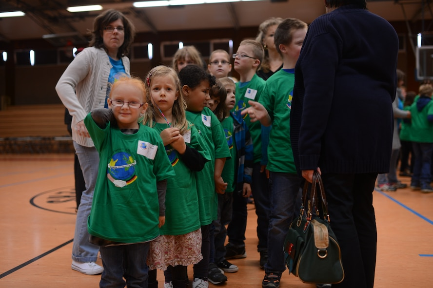 "Children from St. Martin School line up before being assigned a ""buddy"" in the Skelton Memorial Fitness Center on Spangdahlem Air Base, Germany, Oct. 16, 2014. The base volunteers served as a child's ""buddy,"" which entails one of two or three people assigned to every child aiding them in completing the sporting activities and keeping their scorecard. (U.S. Air Force photo by Senior Airman Gustavo Castillo/Released)"