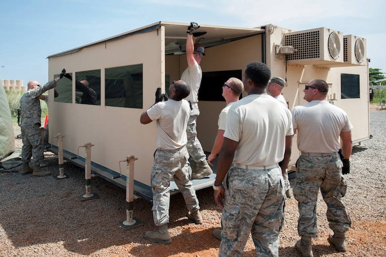 Airmen from the Kentucky Air National Guard's 123rd Contingency Response Group set up a mobile airfield operations center at Léopold Sédar Senghor International Airport in Dakar, Senegal, Oct. 17, 2014, in support of Operation United Assistance, the U.S. Agency for International Development-led, whole-of-government effort to respond to the Ebola outbreak in West Africa. The Airmen are operating an Intermediate Staging Base in Dakar to funnel humanitarian aid into affected areas, working in concert with Soldiers from the U.S. Army's 689th Rapid Port Opening Element to staff a Joint Task Force-Port Opening. (U.S. Air National Guard photo by Maj. Dale Greer)