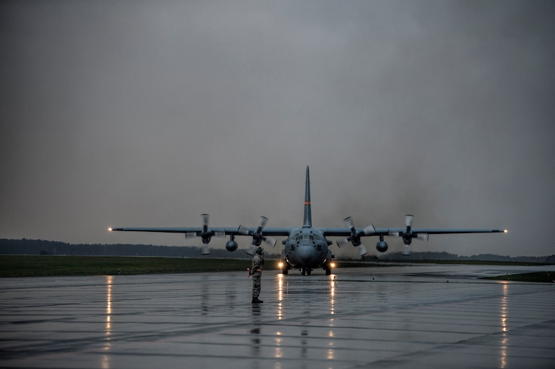 A C-130 Hercules taxi on the flightline Oct. 20, 2014, during U.S. Air Force Aviation Detachment rotation 15-1, at Powidz Air Base, Poland. The C-130s are assigned to Illinois Air National Guard's 182nd Airlift Wing. The guardsmen's night mission performed on-station training to test their capability to perform missions in low-light sorties. The U.S. Air Force's forward presence in Europe allows allies and partners to develop and improve ready air forces capable of maintaining regional security. (U.S. Air Force photo/Staff Sgt. Christopher Ruano)