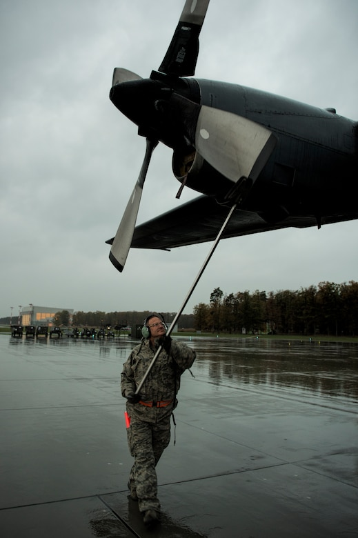 Tech. Sgt. Press Chapin positions the propeller of a C-130 Hercules Oct. 20, 2014, at Powidz Air Base, Poland. The Illinois Air National Guard and Polish airmen have learned and worked together for more than 20 years on a variety of exercises and events, building interoperability through the partnership program. Chapin is a crew chief with the Illinois ANG's 182nd Airlift Wing. (U.S. Air Force photo/Staff Sgt. Christopher Ruano)