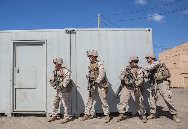 U.S. Marines with Battalion Landing Team, 3rd Battalion, 1st Marine Regiment, 15th Marine Expeditionary Unit, prepare to breach a door during a helicopter-raid exercise aboard Camp Pendleton, Calif., Oct. 16, 2014. BLT 3/1 is scheduled to deploy as the 15th MEU's ground combat element next spring. (U.S. Marine Corps photo by Sgt. Emmanuel Ramos/Released)