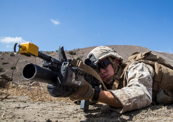U.S. Marine Lance Cpl. Matthew A. Dailey provides security during a helicopter-raid exercise aboard Camp Pendleton, Calif., Oct. 16, 2014. Dailey is a team leader with Kilo Company, Battalion Landing Team, 3rd Battalion, 1st Marine Regiment, 15th Marine Expeditionary Unit. BLT 3/1 is scheduled to deploy as the 15th MEU's ground combat element next spring. (U.S. Marine Corps photo by Sgt. Emmanuel Ramos/Released)
