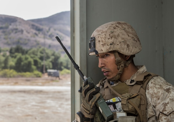 U.S. Marine Sgt. Paul Luna radios for an extraction during a helicopter-raid exercise aboard Camp Pendleton, Calif., Oct. 16, 2014. Luna is a squad leader with Kilo Company, Battalion Landing Team, 3rd Battalion, 1st Marine Regiment, 15th Marine Expeditionary Unit. BLT 3/1 is scheduled to deploy as the 15th MEU's ground combat element next spring. (U.S. Marine Corps photo by Sgt. Emmanuel Ramos/Released)