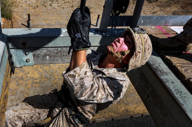 U.S. Marine Cpl. Trevor Hoyt rappels during a helicopter rope-suspension techniques masters course aboard Camp Pendleton, Calif., Oct. 14, 2014. Hoyt is a team leader with Battalion Landing Team, 3rd Battalion, 1st Marines, 15th Marine Expeditionary Unit.  BLT 3/1 is deploying this spring as the 15th MEU's ground combat element. (U.S. Marine Corps photo by Cpl. Steve H. Lopez/Released)