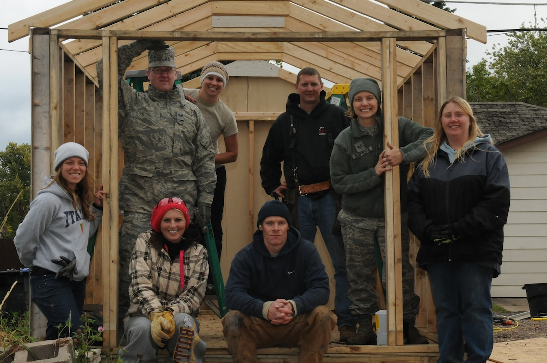 Airmen with the 148th Fighter Wing and Habitat for Humanity volunteers showcase the construction progress of a shed Oct. 4, 2014.  Duluth, Minn. based members of the Minnesota Air National Guard volunteered for their third straight year, working with Habitat for Humanity on community construction projects.  (U.S. Air National Guard photo by Tech. Sgt. Amie M. Muller)
