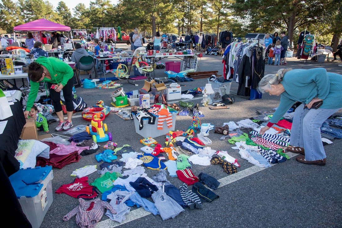 Shoppers look at items at a yard sale held by the 23d Force Support Squadron Oct. 18, 2014 at Moody Air Force Base, Ga. Base yard sales allow military personnel and the public to buy and sell goods at an affordable price. (U.S. Air Force photo by Senior Airman Sandra Marrero/Released)