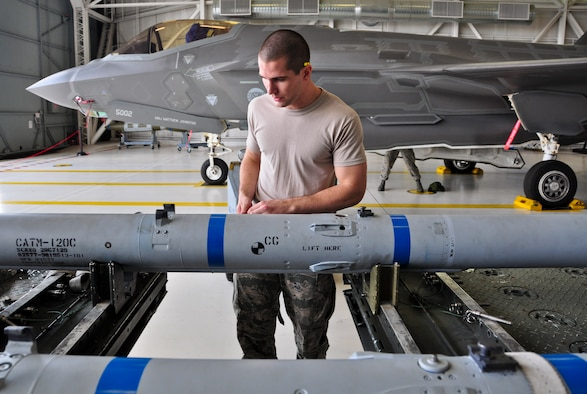 Airman 1st Class Reece Zoller makes an AIM-120 advanced medium-range air-to-air missile safe before loading it onto an F-35A Lightning II during a qualification load Oct. 10, 2014, at Eglin Air Force Base, Fla. The F-35 training program at Eglin AFB currently serves as the primary source of F-35 expertise to new F-35A units across the Air Force. Zoller is a load crewmember from the 58th Aircraft Maintenance Unit crew one. (U.S. Air Force photo/Staff Sgt. Marleah Robertson)