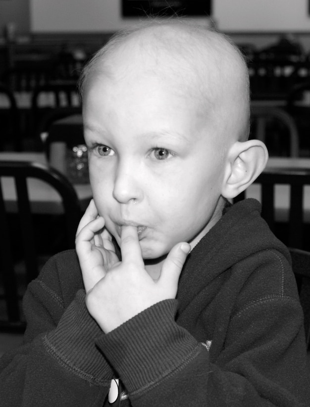 Ty Nordstrom and his family celebrate his fifth birthday at a pizza restaurant December 2007, in Abilene, Texas. Ty was diagnosed with non-rhabdomyosarcoma cancer in October 2007.  He passed away November 2009 – one month before his seventh birthday. Ty's dad, Master Sgt. Lyle Nordstrom, the 352nd Special Operations Group Inspector General superintendent, shares the story of his loss to raise awareness of childhood cancer.  (Courtesy photo)