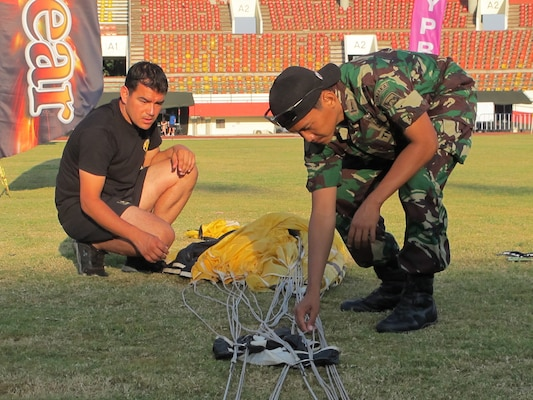 SFC Christopher Acevedo and US Liaison Indra packing a parachute at the 38th Conseil International du Sport Militaire (CISM) in Solo, Indonesia 17-28 September
