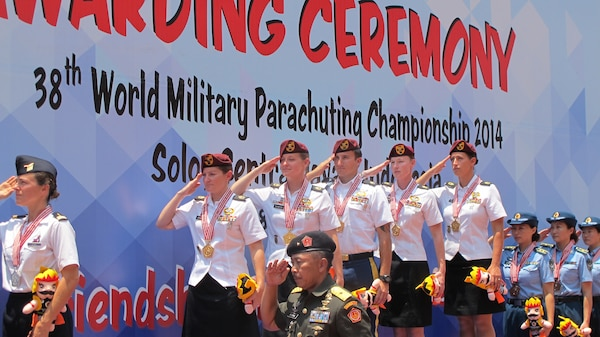 US Women's team on the podium salute as the US National Anthem plays at the 38th Conseil International du Sport Militaire (CISM) in Solo, Indonesia 17-28 September