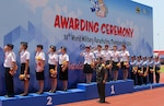 US Women's team on the podium salute as the US National Anthem plays SFC Jennifer Davidson, SFC Laura Dickmeyer, SSG Matt Navarro, SFC Angela Nichols, SFC Dannielle Woosley at the 38th Conseil International du Sport Militaire (CISM) in Solo, Indonesia 17-28 September