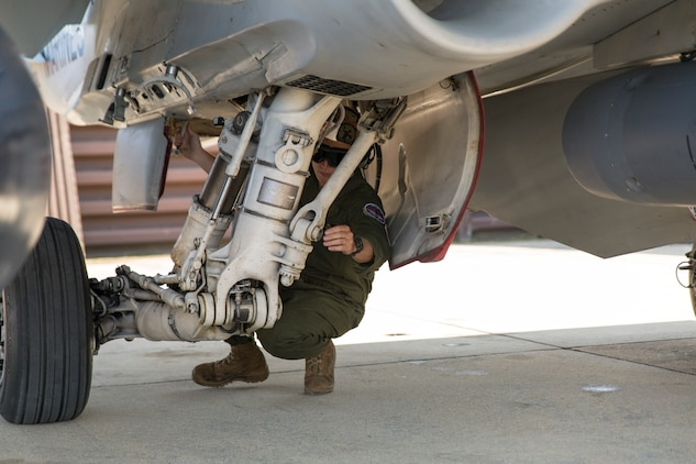 Sgt. Jeffrey Failing, a powerline mechanic with Marine All-Weather Fighter Attack Squadron 533, conducts a maintenance check on an F/A-18 Hornet during the Korean Marine Exchange Program 14-13, Oct. 13, 2014, on Osan Air Base, Republic of Korea. KMEP 14-13 is a multinational exercise that focuses on the integration of aviation and ground assets within the construct of a traditional Combined Arms Live Fire Exercise. Supporting units include, but are not limited to, Marine Aviation Logistics Squadron 12 and Marine Wing Support Squadron 171.