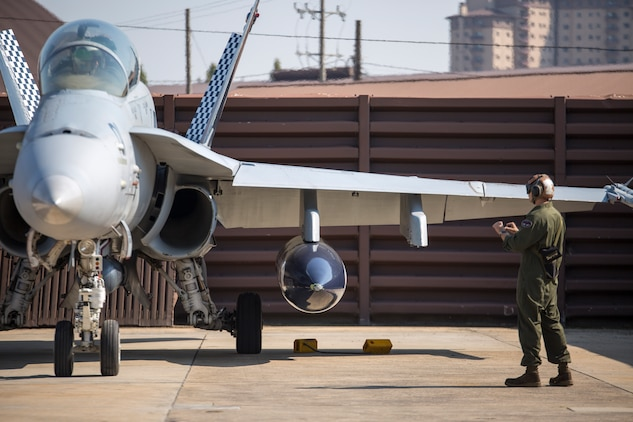 Cpl. Nicholas Cochran, a powerline mechanic with Marine All-Weather Fighter Attack Squadron 533, conducts pre-flight checks on an F/A-18 Hornet during the Korean Marine Exchange Program 14-13, Oct. 13, 2014, on Osan Air Base, Republic of Korea. KMEP 14-13 is a multinational exercise that will focus on the integration of aviation and ground assets within the construct of a traditional Combined Arms Live Fire Exercise. Supporting units include, but are not limited to, Marine Aviation Logistics Squadron 12 and Marine Wing Support Squadron 171.