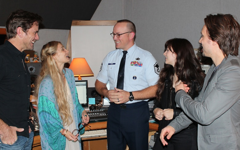 "Master Sgt. Harry Kibbe chats with TV's Nashville cast members, from left, Charles ""Chip"" Esten, Clare Bowen, Aubrey Peeples and Jonathan Jackson.  Kibbe interviewed the actors for the 2014 ""Red, White and Air Force Blue Christmas"" radio special. The one-hour program will be sent to more than 3,000 country radio stations in the United States and the Armed Forces Network for airing during the upcoming holiday season. Air Force Recruiting Service produces the annual holiday special. (U.S. Air Force photo/Dale Eckroth)"
