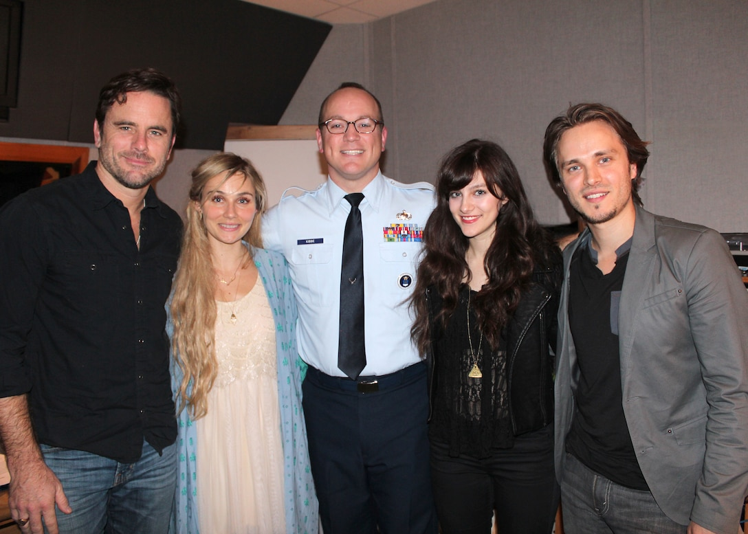 """Master Sgt. Harry Kibbe is joined by TV's Nashville cast members, from left, Charles """"Chip"""" Esten, Clare Bowen, Aubrey Peeples and Jonathan Jackson for the 2014 """"Red, White and Air Force Blue Christmas"""" radio special. It will air on be country stations in the United States and on the Armed Forces Network during the upcoming holiday season. The show is produced by the Air Force Recruiting Service. (U.S. Air Force photo/Dale Eckroth)"""