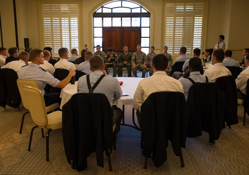Cadets from Air Force Detachment 765 at The Citadel in Charleston, S.C.,  listen to Joint Base Charleston company grade officers as they speak about their respective careers and overall Air Force mission Oct. 22, 2014, at the Charleston Club on JB Charleston, S.C. The cadets were given the opportunity to listen to JB Charleston CGO's during a mentorship conference where the cadets learned about the different jobs and careers available to them, and also the demands expectated of future second lieutenents. (U.S. Air Force photo/Airman 1st Class Clayton Cupit)