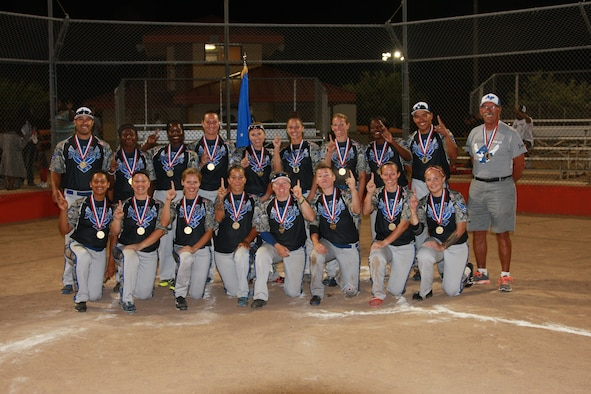 The 2014 All-Air Force Women's Softball team poses for a group photo after winning the gold medal during the 2014 Armed Forces Softball Championship at Fort Sill, Okla., Sept 19, 2014. (photo by Steve Brown)