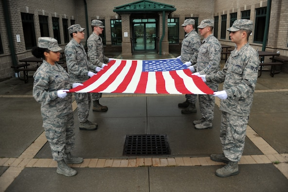 WESTHAMPTON BEACH, NY - Members of the 106th Rescue Wing Honor Guard participate in a flag ceremony during training on October 16, 2014 at FS Gabreski ANG.