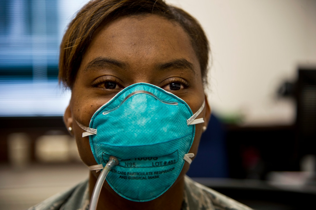Tech. Sgt. Saquadrea Crosby, 86th Aerospace Medicine Squadron public health NCOIC, gets fitted for an N95 respirator by 86th Bioenvironmental Engineering flight at Ramstein Air Base, Germany, Oct. 17, 2014. The N95 respirator is a device that is used to help prevent the spread of germs (viruses and bacteria) from one person to another. As members of the 86th Airlift Wing continue to support missions for Operation United Assistance, Airmen who are expected to interact with returnees from Ebola infected areas will be fitted for the N95 respirators. (U.S. Air Force photo by Staff Sgt. Sara Keller)