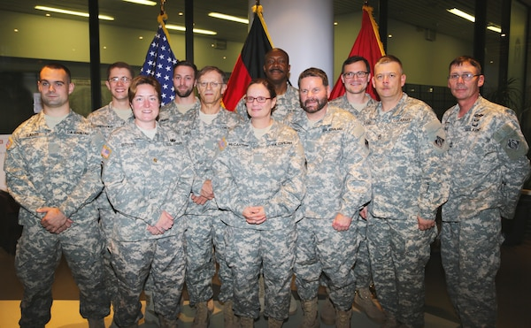 The Forward Engineering Support Team-Advanced, deploying to Liberia in support of Operation United Assistance, is honored with a departure ceremony at U.S. Army Corps of Engineers Europe District headquarters in Wiesbaden, Germany Oct. 20, 2014. The 13-member team of military and civilian technical experts — from electrical and environmental engineers, to real estate and power generation specialists — will support the construction of Ebola Treatment Units as part of the operation. The ETUs will be constructed at site locations chosen by the Government of Liberia Ministry of Health and the Armed Forces of Liberia to assist in the containment of Ebola. Additionally, USACE military and civilian personnel will assist with the construction, planning, surveying, and design of life-support and logistics facilities in Senegal and Liberia. U.S. Agency for International Development is the lead U.S. Government organization for the operation and U.S. Africa Command is supporting the effort by providing command and control, logistics, training and engineering assets — including the FEST-A — to contain the Ebola virus outbreak in West African nations.