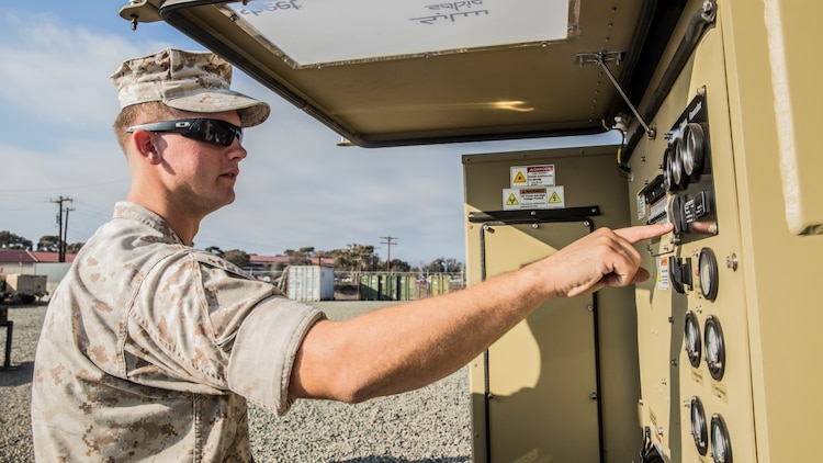 U.S. Marine Sgt. Michael Clifton inspects a Very Small Aperture Terminal-Large system aboard Camp Pendleton Calif., Oct. 20, 2014. Clifton, 24, from Galveston, Texas, is an AN/TRC-170 technician with the 15th Marine Expeditionary Unit aboard Camp Pendleton, Calif. (U.S. Marine Corps photo by Sgt. Emmanuel Ramos/Released)