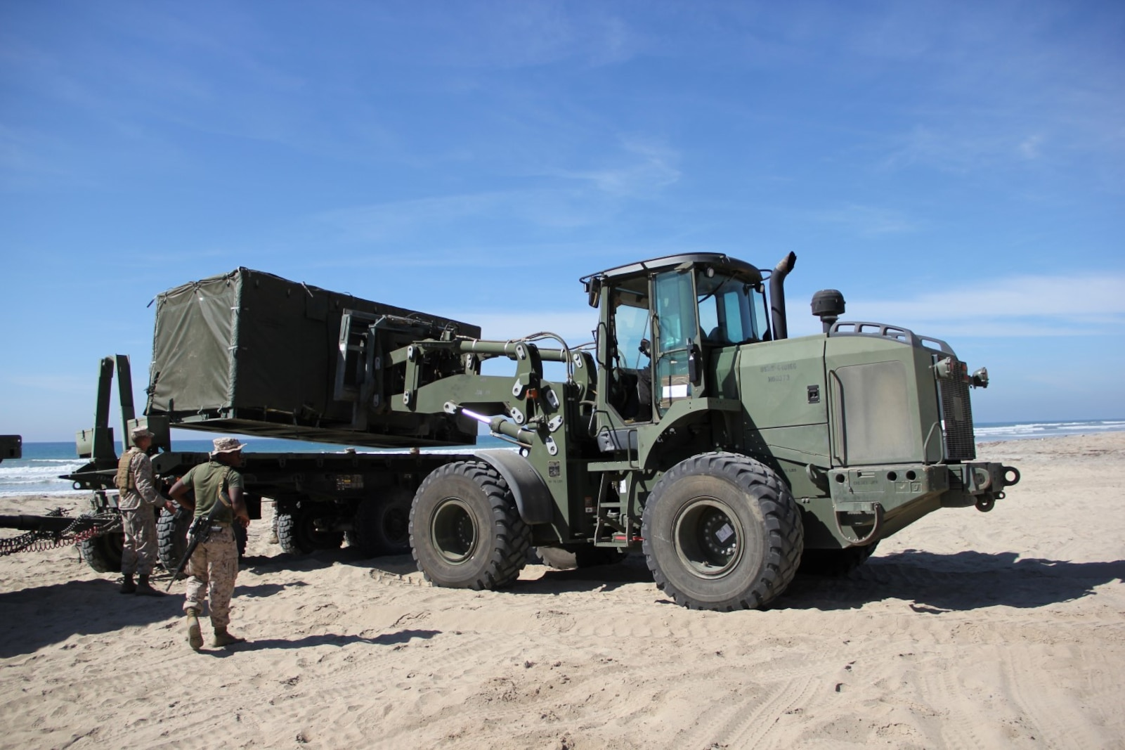 Marines with Marine Wing Support Squadron 373 unload components of the Tactical Water Purification System during exercise Pacific Horizon 2015 at Marine Corps Base Camp Pendleton, Calif., Oct. 22. PH 15 increases the ability of 1st Marine Expeditionary Brigade and Expeditionary Strike Group 3 to plan, communicate and conduct complex sea and shore based operations in response to natural disasters. (U.S. Marine Corps photo by Lance Cpl. Caitlin Bevel)
