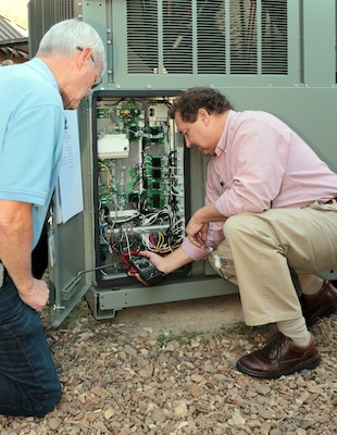 Hays Kinslow, energy manager for the 63rd Regional Support Command, and Bradley Brown, resource efficiency manager, measure the current draw of a newly installed scroll chiller at Camp Robinson in North Little Rock, Arkansas. Newly assigned to the Army Reserve's 63rd RSC, Bradley brings more than 20 years of energy related commercial, industrial and defense experience, with special focus on heating, ventilating and air conditioning and energy management control system technologies, to help the command meet its energy goals.