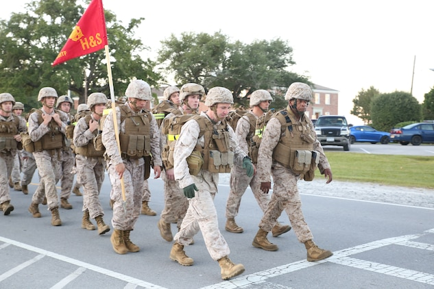 Maj. Justin D. Lokkesmoe, left front, company commander, Headquarters and Service Company, Ground Combat Element Integrated Task Force, and 1st Sgt. Jonathan D. Borders, right front, company first sergeant, H&S Co., GCEITF, lead a combat conditioning hike aboard Marine Corps Base Camp Lejeune, North Carolina, Oct. 23, 2014. The hike was the first executed by H&S company since the establishment of the GCEITF. From October 2014 to July 2015, the Ground Combat Element Integrated Task Force will conduct individual and collective skills training in designated combat arms occupational specialties in order to facilitate the standards based assessment of the physical performance of Marines in a simulated operating environment performing specific ground combat arms tasks. (U.S. Marine Corps photo by Cpl. Paul S. Martinez/Released)