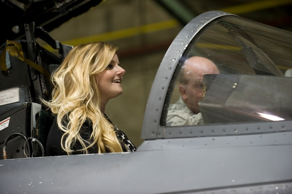 Jaime Thompson, U.S. Navy Lt. Seymour Johnson's great-granddaughter, receives an introduction to the cockpit of an F-15E Strike Eagle Oct. 17, 2014, during a tour at Seymour Johnson Air Force Base, N.C. During her visit, Thompson familiarized herself with Seymour Johnson's history and for the first time in her life was able to discover the full legacy left behind by her great-grandfather. (U.S. Air Force photo/Airman 1st Class Aaron Jenne)