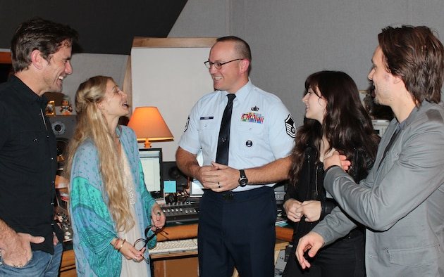 "Master Sgt. Harry Kibbe chats with TV's 'Nashville' cast members, from left, Charles ""Chip"" Esten, Clare Bowen, Jonathan Jackson and Aubrey Peeples. Kibbe interviewed the actors for the 2014 ""Red, White and Air Force Blue Christmas"" radio special. The one-hour program will be sent to more than 3,000 country radio stations in the U.S. and the Armed Forces Network for airing during the upcoming holiday season. Air Force Recruiting Service produces the annual holiday special. (U.S. Air Force photo/Dale Eckroth)"
