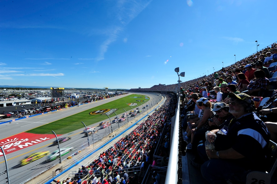 The crowd watches as the cars speed by during the Geico 500 race at the Talladega Superspeedway in Talladega, Ala., Oct. 10, 2014. The Talladega Superspeedway is arguably NASCAR's most competitive race. (U.S. Air Force photo by Airman 1st Class Alexa Culbert)
