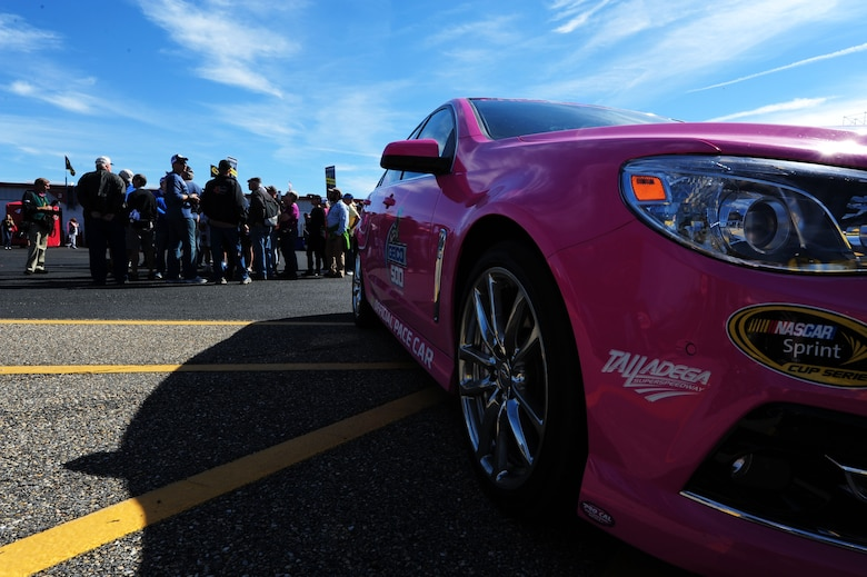 The pace car sits outside the garage and pit area at the Talladega Superspeedway in Talladega, Ala., Oct. 19, 2014. The pace car was painted pink in honor of breast cancer awareness month. (U.S. Air Force photo by Airman 1st Class Alexa Culbert)