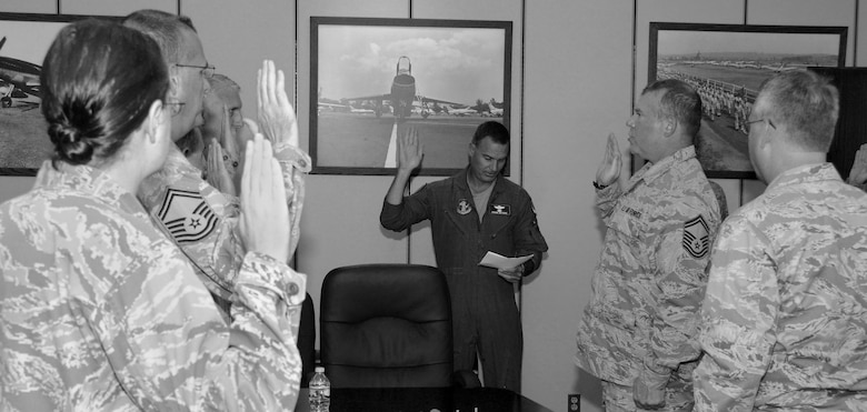 Col. Frank Detorie, commander of the 103rd Airlift Wing, administers the oath of responsibility to approximately 25 Airmen who are newly appointed members of the wing's inspection team, at Bradley Air National Guard Base, East Granby, Conn., June 10, 2014.  The Airmen will replace the exercise evaluation team and will develop and evaluate exercises, track compliance and issues, and report to the commander.   (U.S. Air National Guard photo by Tech. Sgt. Joshua Mead)