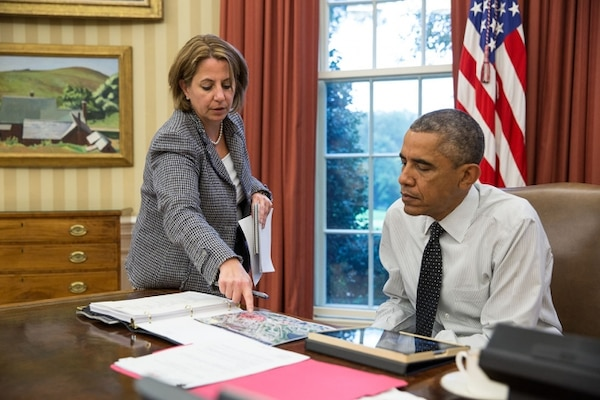 Lisa Monaco, assistant to the president for homeland security and counterterrorism, updates President Barack Obama in the Oval Office on the shooting in Canada prior to his phone call with Prime Minister Stephen Harper, Oct. 22, 2014. White House Photo by Pete Souza