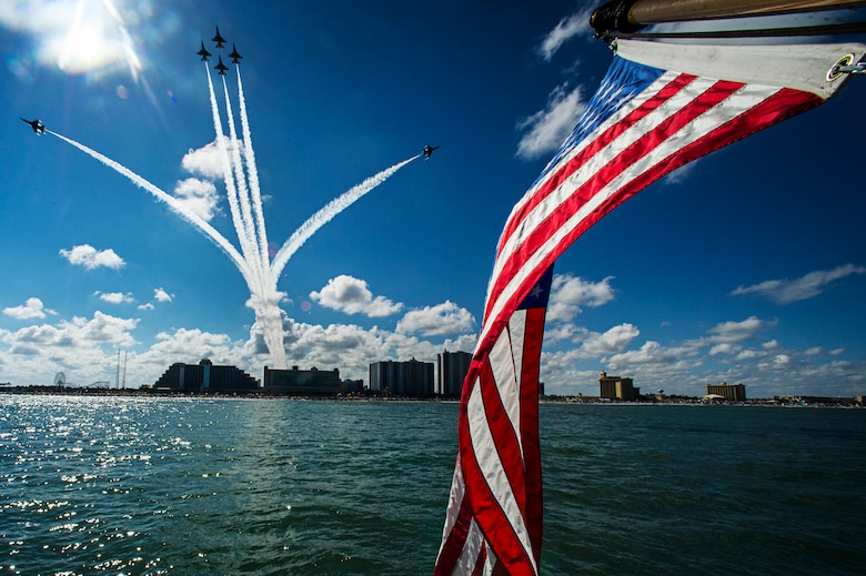 The Thunderbirds perform the 'Delta Opener' during the Wings and Waves Air Show Oct. 12, 2014, at Daytona Beach, Fla. The Thunderbirds are the Air Force's precision flying demonstration team, flying F-16 Fighting Falcons. (U.S. Air Force photo/Tech. Sgt. Manuel J. Martinez)
