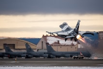 An F-16 Fighting Falcon takes off Oct. 15, 2014, at Eielson Air Force Base, Alaska, during Red Flag-Alaska 15-1. The Pacific Air Forces commander-directed field training exercises for U.S. and partner nation forces provide combined offensive counter-air, interdiction, close air support and large force employment training in a simulated combat environment. The F-16 is assigned to the 18th Aggressor Squadron at Eielson AFB. (U.S. Air Force photo/Senior Airman Peter Reft)