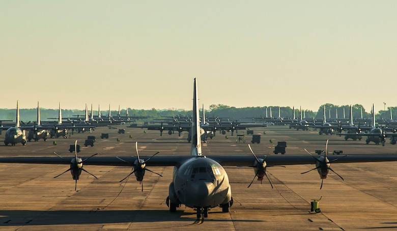 Numerous C-130 Hercules sit on the parking apron Oct. 17, 2014, at Little Rock Air Force Base, Ark. The base has more than 8,000 active-duty military and civilian members who focus on delivering premiere C-130 combat airlift and ensuring mission-ready Airmen. (U.S. Air Force photo/Airman 1st Class Harry Brexel)