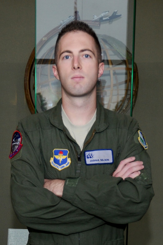 2nd Lt. Joshua Nelson poses for a portrait at the 47th Flying Training Wing headquarters on Oct. 23, 2014. Nelson was credited for stopping a potential murder, then stopping a potential suicide, during a trip to Walmart.(U.S. Air Force photo by Staff Sgt. Steven R. Doty)