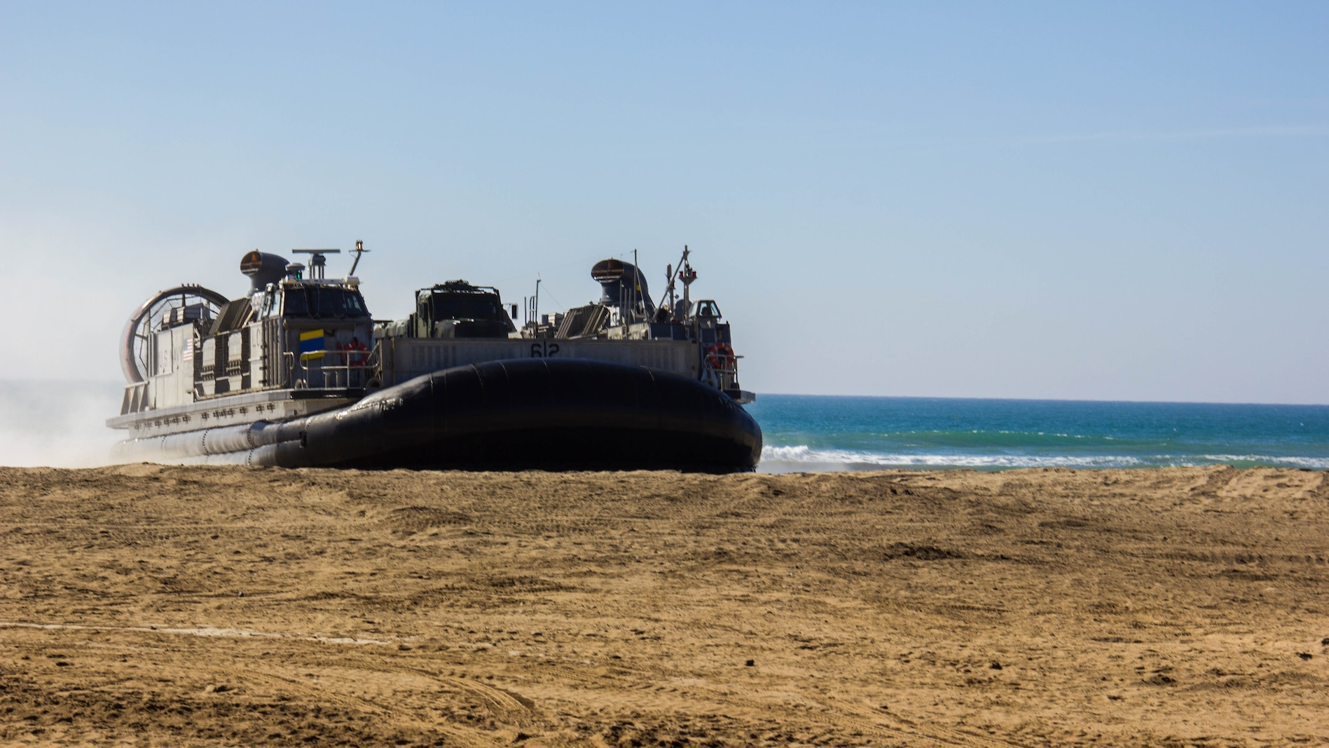 A Landing Craft, Air Cushions assigned to Assault Craft Unit 5 while makes a beach landing while performing a ship-to-shore drill during exercise Pacific Horizon 2015 aboard Marine Corps Base Camp Pendleton, Calif., Oct 23. PH 15 is a scenario driven, simulation supported crisis response exercise designed to improve 1st Marine Expeditionary Brigade's and Expeditionary Strike Group 3's interoperability and strengthen Navy-Marine Corps relations by conducting an in-stream Maritime Prepositioning Force offload of equipment by providing host country civil-military security assistance, and by conducting infrastructure restoration support from Oct. 20-28.
