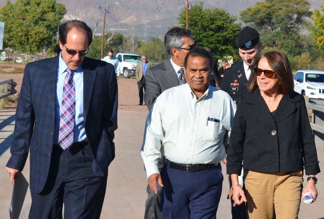 SOCORRO, N.M., -- (r-l), Assistant Secretary of the Army (Civil Works) Jo-Ellen Darcy joins Chief Engineer and CEO of the Middle Rio Grande Conservancy District Subhas Shah, and Deputy Engineer John D'Antonio at the groundbreaking ceremony for the first two phases of the San Acacia Levee project, Oct. 22, 2014.