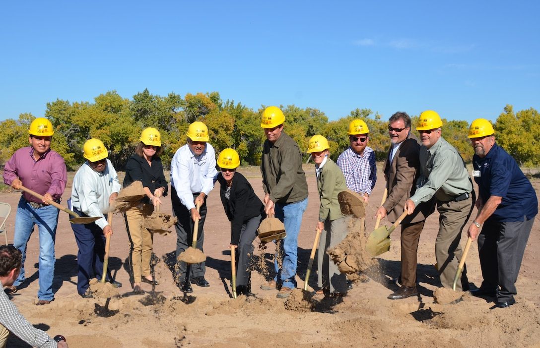 SOCORRO, N.M., -- The Honorable Jo-Ellen Darcy, Assistant Secretary of the Army (Civil Works), (third from left), joins representatives from various agencies to break ground on the first two phases of the San Acacia Levee project, Oct. 22, 2014.
