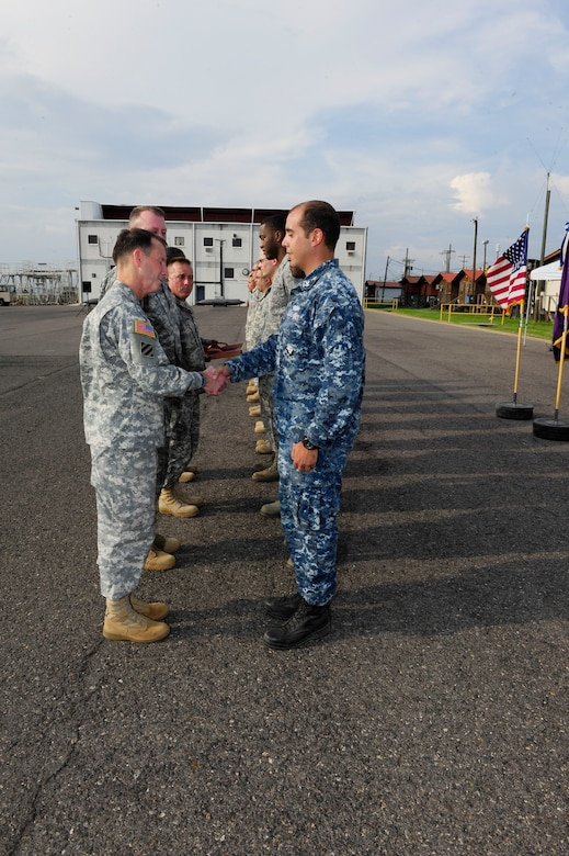 At the end of his tour, Maj. Gen. Joseph P. DiSalvo awarded 10 Joint Task Force-Bravo service members with the Army Achievement Medal and the Army South Commanding General coin for their outstanding performance during their tenure at Soto Cano Air Base, Honduras, Oct.21, 2014. (Photo by Martin Chahin)
