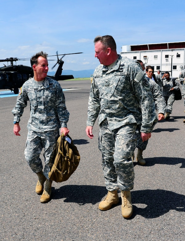 Maj. Gen. Joseph P. DiSalvo, U.S. Army South Commanding General, was greeted by Col. Kirk Dorr, Joint Task Force-Bravo Commander, and Col. Rollin Miller, Army Support Activity Commander, on the flightline at Soto Cano Air Base, Honduras, Oct. 21 2014. Maj. Gen. DiSalvo visited different areas of the post to learn more about the continued efforts to upgrade infrastructure and to recognize personnel for their accomplishments (Photo by Martin Chahin)