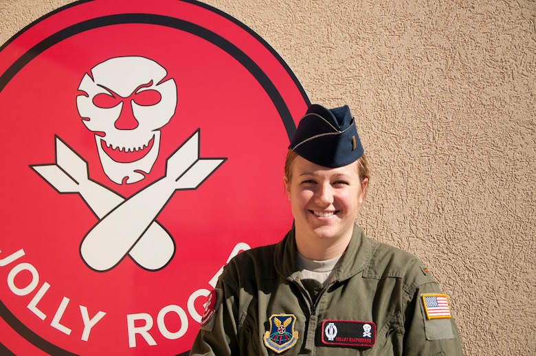 Second Lt. Holley Macpherson, 320th Missile Squadron deputy missile combat crew commander, poses outside the 90th Operations Group Oct. 20, 2014. Recently, Macpherson pulled her first alert in a launch control center in the F.E. Warren Air Force Base, Wyo., Missile Complex , where she and a crew commander monitored the ICBM mission in their flight area. (U.S. Air Force photo by Senior Airman Jason Wiese)