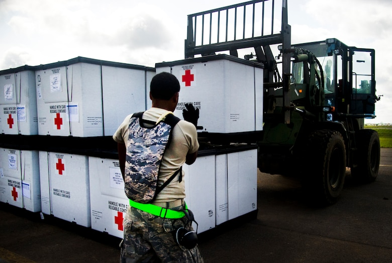 ROBERTS INTERNATIONAL AIRPORT, Republic of Liberia - U.S. Air Force Airmen part of the Joint Task Force-Port Opening team of the 621st Contingency Response Wing assigned to Joint Base McGuire-Dix-Lakehurst, N.J., finish unloading medical supplies during Operation UNITED ASSISTANCE here, October 16, 2014. The JTF-PO is supporting a comprehensive U.S. government effort led by the U.S Agency for International Development, to support the World Health Organization and other international partners to help the Governments of Guinea, Liberia, and Sierra Leone respond to and contain the outbreak of the Ebola virus in West Africa. (U.S. Air Force photo/Staff Sgt. Gustavo Gonzalez/RELEASED)